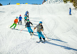 Group of people skiing down mountain